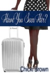 An attractive black woman's legs next to a flight bag.